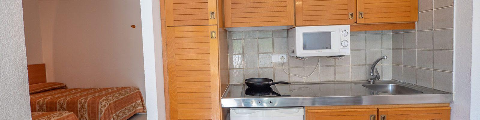 Apartamento D Vista camas y cocina